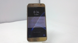 Samsung Galaxy S7 SM-G930VC, Unknown Carrier, Gold, Cracked Glass